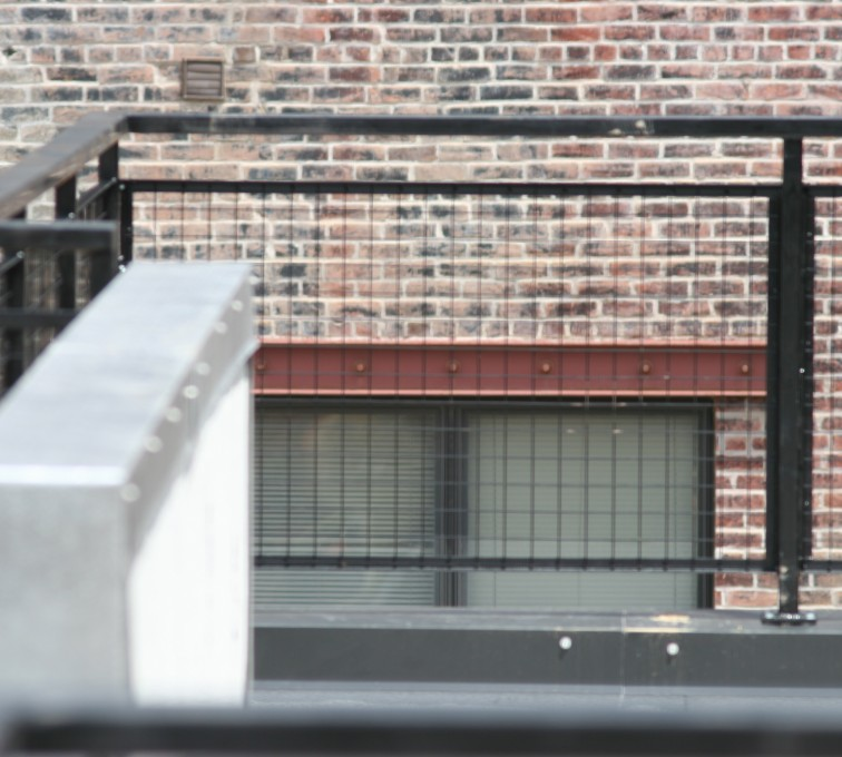 AFC Ames - Custom Railing, 2205 Railing with mesh infill