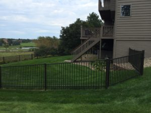 Sioux City ornamental flat top fencing in a residential backyard